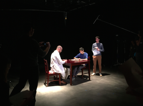 Senior Ben Zeitz-Moskin, Sophomore Phil Minton, and teacher Giles Pugatch work on the set for the class On Location. This film is called Loops of Love.