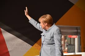 Merkel waves at a public appearance
