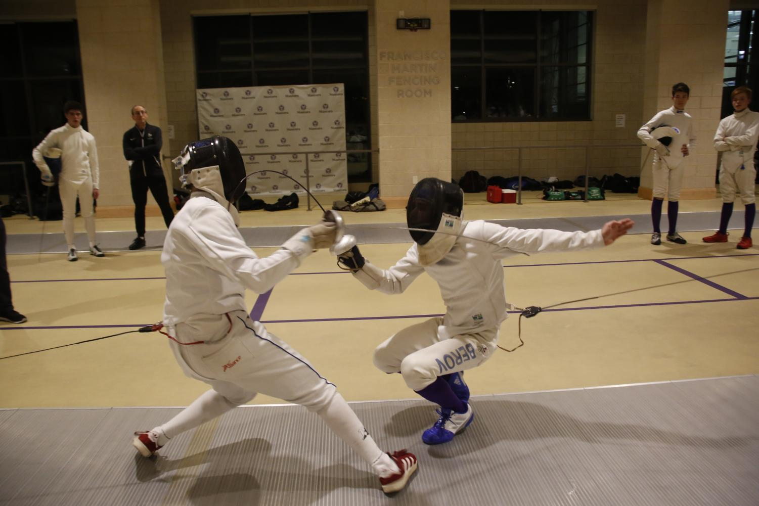Masters fencers compete in the Francisco Martin Fencing Room.