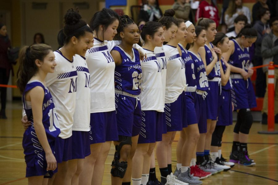 Masters Girls Varsity Basketball stands for the National anthem at the NYSAIS championship. Their success in NYSAIS is a signifier of Masters' future outside of the FAA.