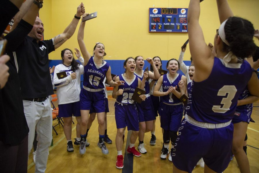 Masters Girls Varsity Basketball celebrates after winning the NYSAIS Championship with a 65-49 victory over Horace Mann.