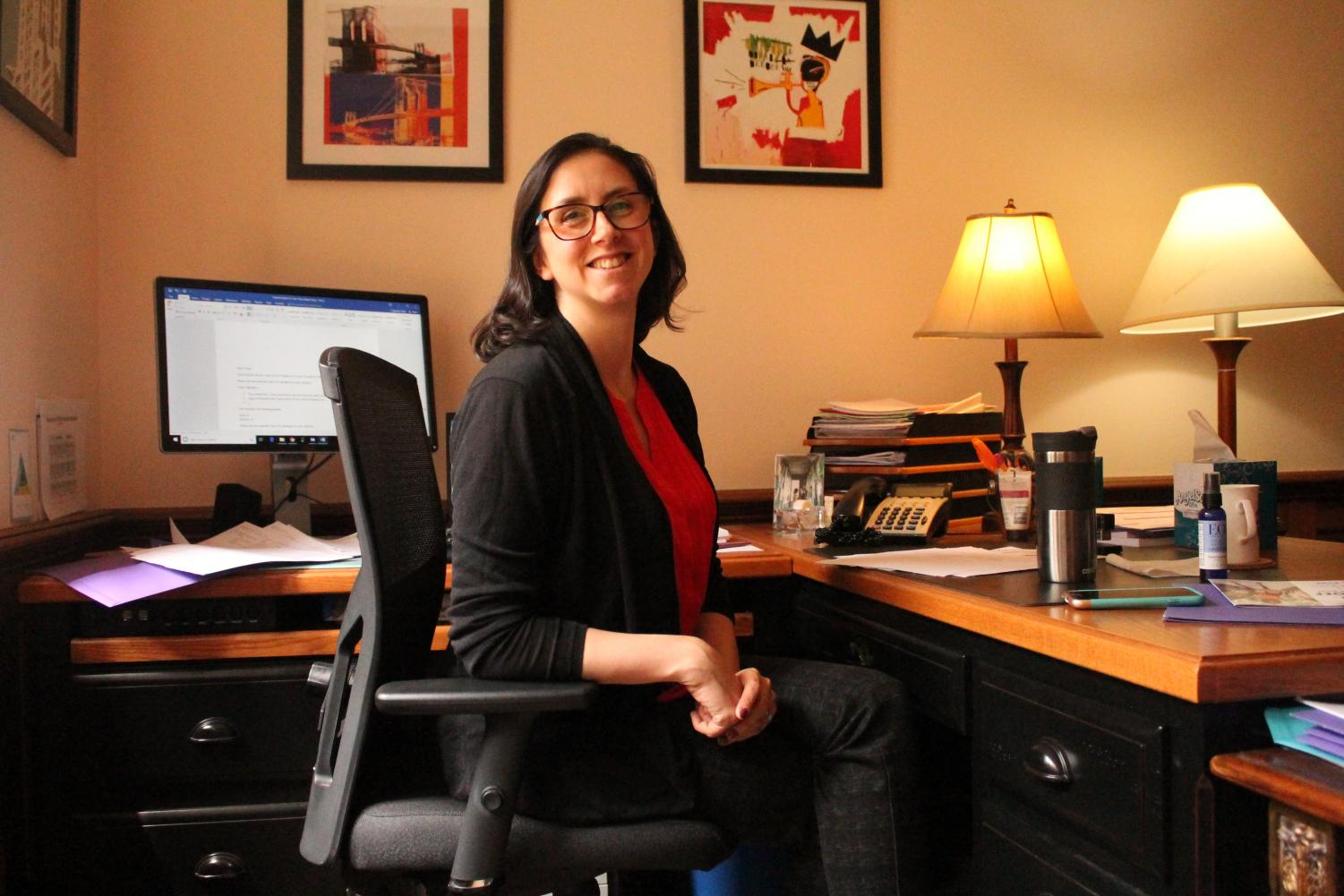 Erica Chapman, Masters' Dean of Faculty works in her office. This will be Chapman's last year at the school, and she will be replaced by Sam Savage, the former chair of Deerfield Academy's language department.