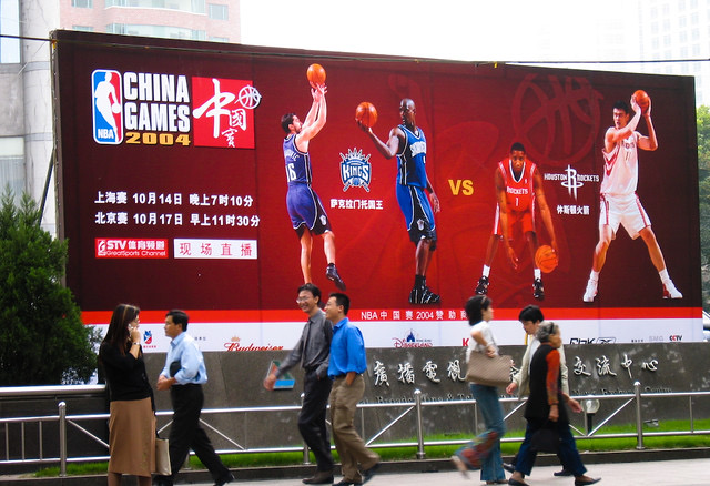 NBA Signage advertises an NBA game featuring the Houston Rockets (and Chinese star Yao Ming) against the Sacramento Kings in 2004.