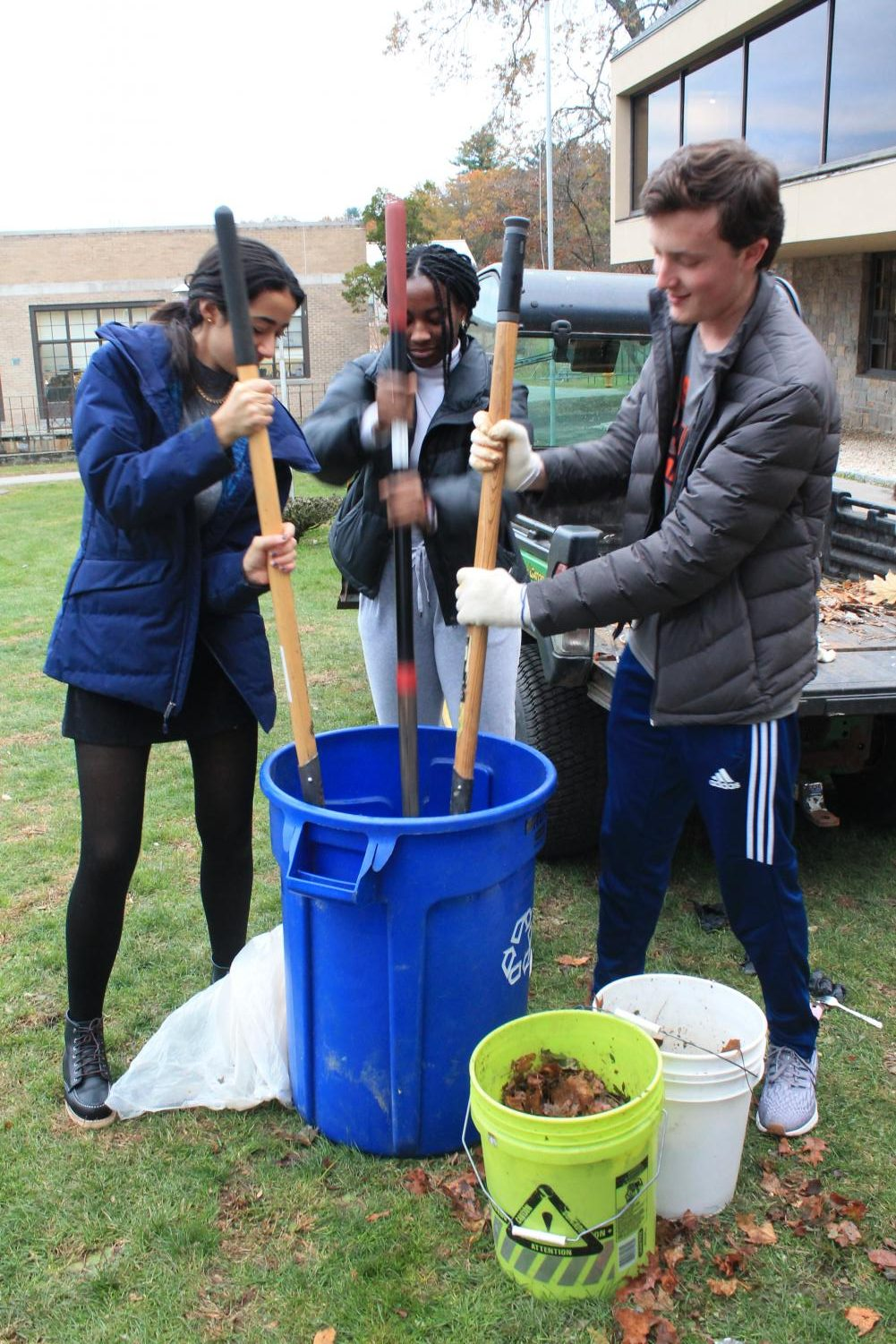 Students help compost during a