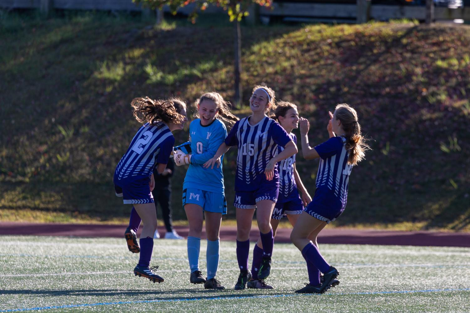 Girls' Varsity Soccer celebrates a 2-1 victory over Convent of the Sacred Heart on Oct. 5. Pictured from left to right are Lauren Marlowe ('23), Francesca Mann ('21), Kwynne Schlossman ('22),  Rachel Schwartz ('21) and Tara Phillips ('23). The team has more wins this year than they've had in any season since 2009.