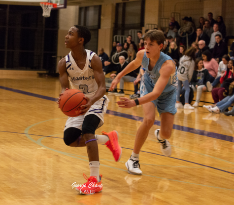 Freshman Stephon Marbury drives into the paint in a game against Columbia Prep.