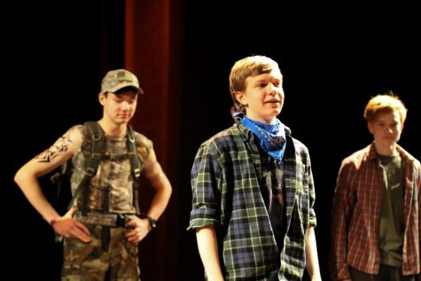 "Senior Owen Pietsch (middle) sings ""Blow Away the Morning Dew"" in The Salting Dead. Pietsch is the oldest member of Salty Dogs, currently in his fourth year."