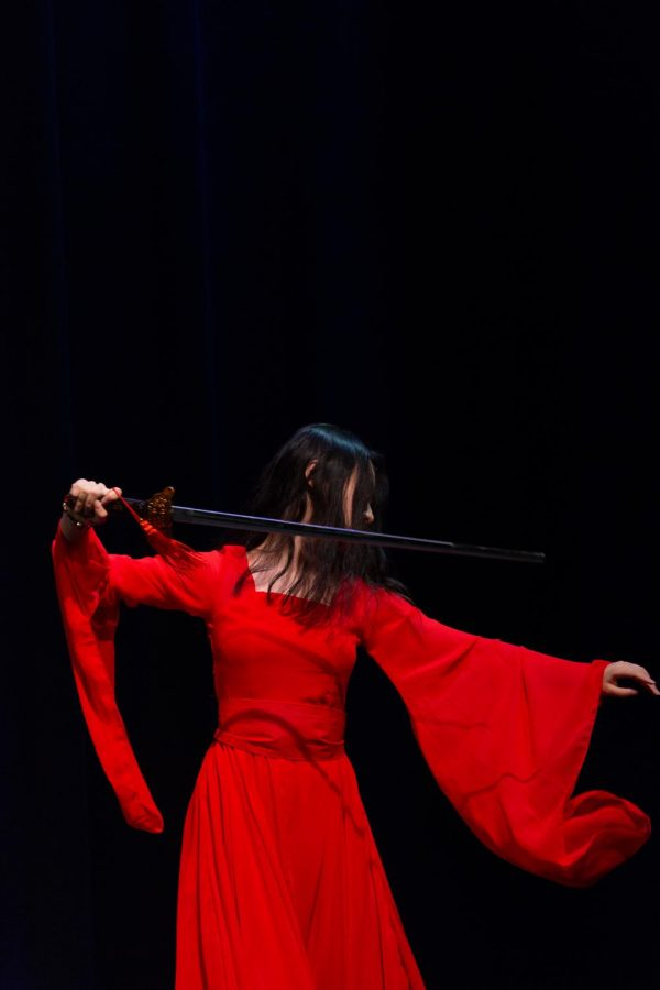 Zara Zhang performs with a sword in her piece, 白蛇传, which translates from Mandarin to