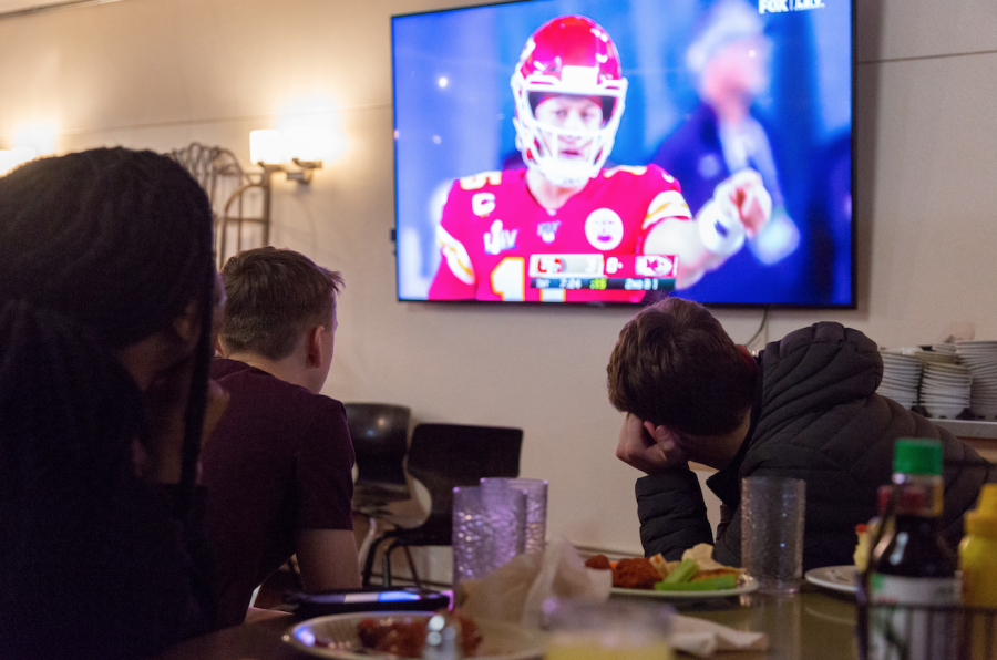 A group of boarding students watched the Superbowl in the dining hall this past Sunday. The next day, the students attended their classes, after a full day of festivities and traditions.