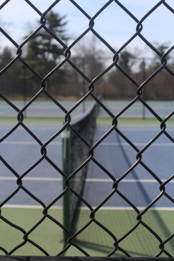 Masters' tennis courts sit untouched during the school's COVID-19 shutdown.