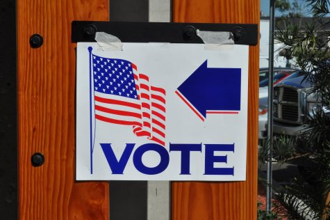 A sign points to a voting location. Primary elections in New York will take place on June 23. Voters have the option of going to polling locations, or sending in an absentee ballot, in order to better socially distance.