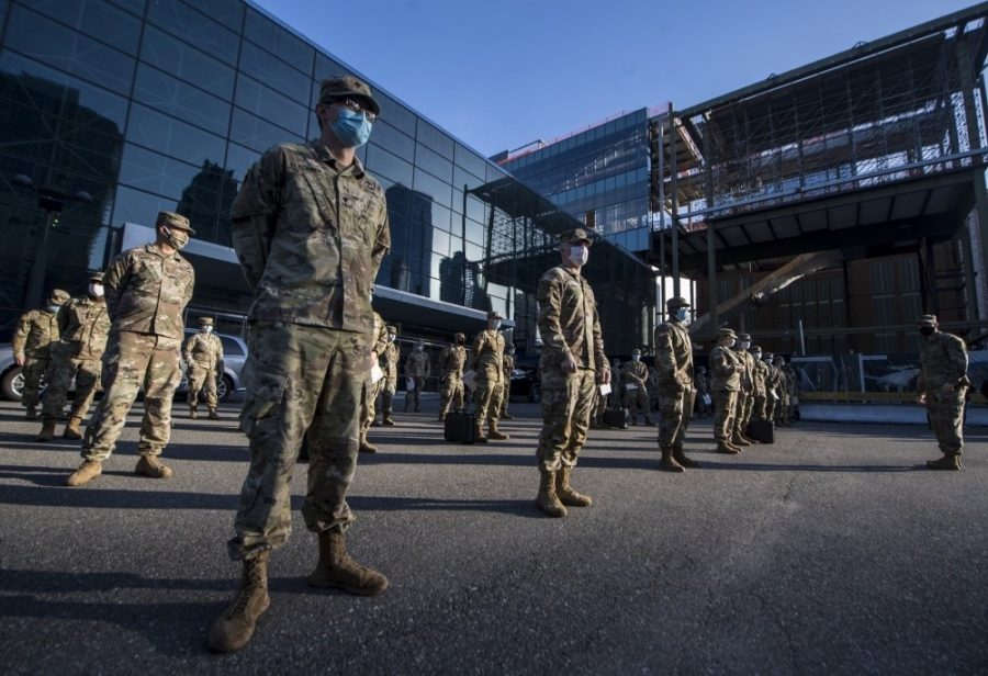 Soldiers stand socially distanced and masked in front of the Javits Center in New York City, which the Army turned into a hospital for the COVID-19 pandemic in early April.