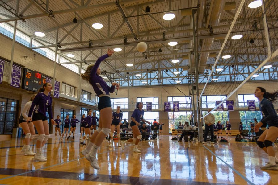 Senior Sophia Herzberg strikes a volleyball during a game last fall. This year, fall sports teams at Masters will begin with a virtual preseason followed by check-ins with their coaches and teammates twice a week once classes begin.