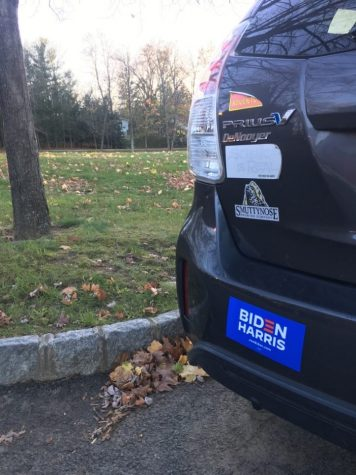 A car is decked out with a Biden-Harris sticker. Many others showed their support with similar merchandise.