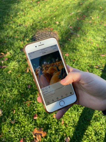 A student scrolls on Instagram, looking at Halloween images. The Masters School found maskless students posting on social media after Halloween parties, causing tension at school.