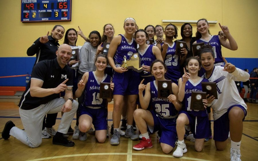 The+girls+varsity+basketball+team+in+2019+after+they+won+their+championship+title.+
