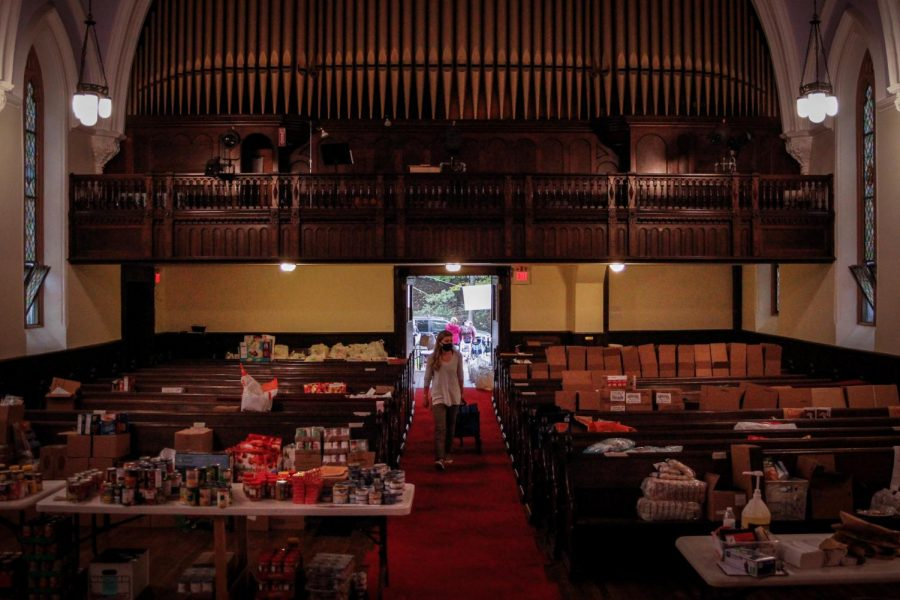 The nave of South Presbyterian Church, the pews of which are filled with food that will be received by the patrons of the Dobbs Ferry Food Pantry.