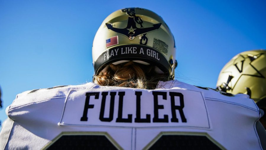 Sarah Fuller, the first woman to play in a Power 5 football game, dons a helmet decal saying,