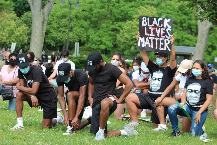 Several+protesters+gather+at+the+Dobbs+Ferry+Waterfront+in+early+June.+The+group%2C+which+included+several+members+of+The+Masters+School+community%2C+joined+together+after+the+murder+of+George+Floyd%2C+an+unarmed+black+man+who+was+killed+by+police+in+Minneapolis+on+May+25.+Several+local+officials+and+students%2C+including+Masters+2020+graduate+Leron+Dugan%2C+spoke+out+against+police+brutality+at+the+protest.