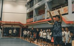Junior Allen Ning takes a three-point jump shot at a local school in Guangzhou, China. Ning practiced with his local basketball team this past season, but he was unable to play in any games because he did not attend the school.