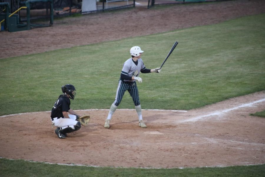Junior Aidan McLaren steps into the batter's box during a night game on Oct. 3, 2020. At the time, McLaren was playing for L & M Baseball. Since then, he switched teams and joined East Coast Elite, for whom he currently plays.