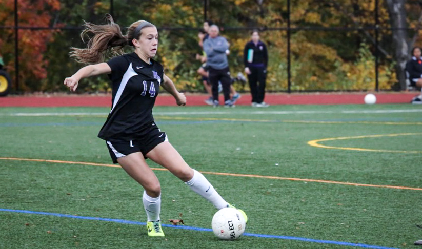 Sam Coffey dribbles the ball in a game during her early high school soccer career. Coffey was a star midfielder at Masters and went on to play Division I soccer at Boston College and then Penn State. Now, she will head off to Portland, Oregon to play for the Thorns of the National Women's Soccer League (NWSL)