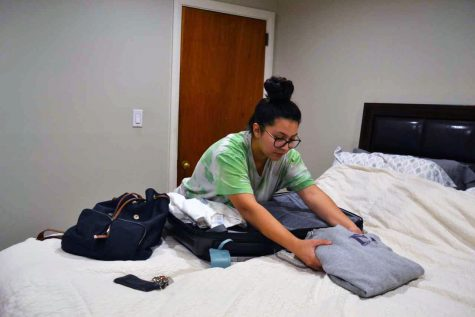 Senior Ariella Uribe packs her clothes and personal belongings to prepare to their return to campus this Saturday.