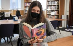 Masters sophomore Stella Simonds sits in the library reading. When the COVID-19 pandemic hit, the book industry went through many ups and downs, but ultimately found success in 2020.