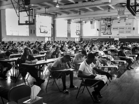 A group of students sweat out their last hour of their history exam in Strayer Gym. Although students did not take any final exams this past school year due to Covid-19, exams typically take place the last week of school.