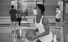 Stephon Marbury II prepare for a three point shot during a boys' varsity basketball practice. Students play with masks on to ensure the safety of themselves and others. Towards the end of the season, the team was able to scrimage in keeping with proper regulations.