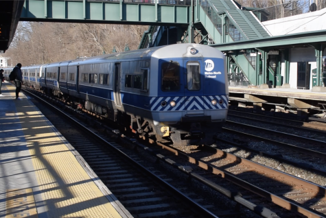 A train races by the station in Dobbs Ferry, NY. Every morning, roughly 40 Masters students and teachers take the train to Dobbs Ferry and are shuttled up to campus by bus.