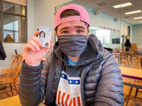 Sophomore Baird Hruska poses with his learners permit after taking the DMV