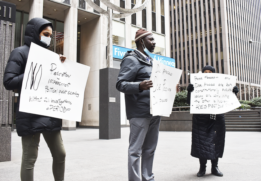 Protesters stand outside the headquarters of the New York Post and Fox News in Midtown Manhattan on April 3, 2021. The rally was organized by Sheikh Musa Drammeh (center) and called for due process in the investigation against Governor Andrew Cuomo (D-NY). Cuomo is facing several allegations of sexual harassment and has been heavily criticized for his handling of COVID-19 in nursing homes during the early stages of the pandemic.