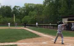 Senior center fielder Nick Albani stands in the batters box during the sixth inning of Masters' season opener at Hackley. The Panthers dropped the contest to the Hornets, by a score of 11-6 in seven innings.