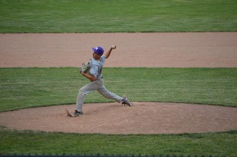 Junior Ethan Rosenberg throws a pitch in Masters
