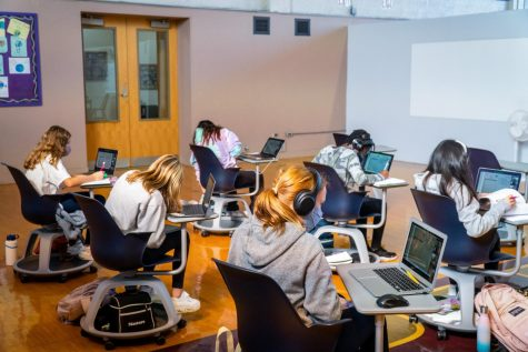 Middle School students sit in a recently constructed classroom in Strayer Hall. Remodeling spaces, such as Strayer and Doc Wilson Hall, was a major expense in bringing students and teachers back to school safely for in-person learning last fall.