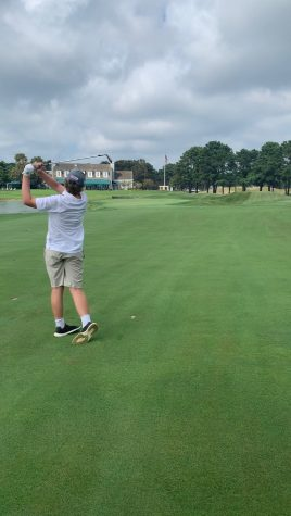 Junior Ethan Schlapp hits his approach shot into the ninth hole of the Lakes course at Colonial Spring Golf Club in August 2020.