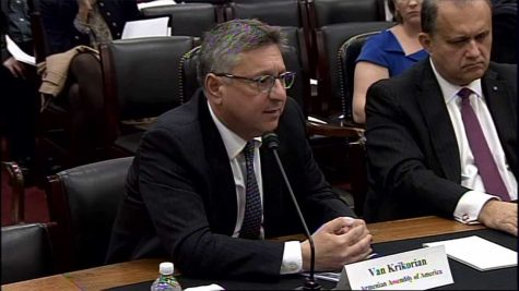 An image of lawyer and leader of thr Armenian Assembly of America, Van Krikorian, speaking to Congress.