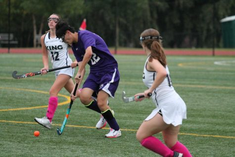 Sophomore Bob Jiao participates in a field hockey game against The King School on October 23.